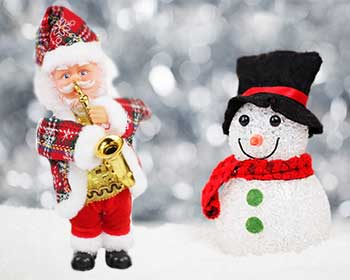 Christmas toy - Santa is playing a saxophone