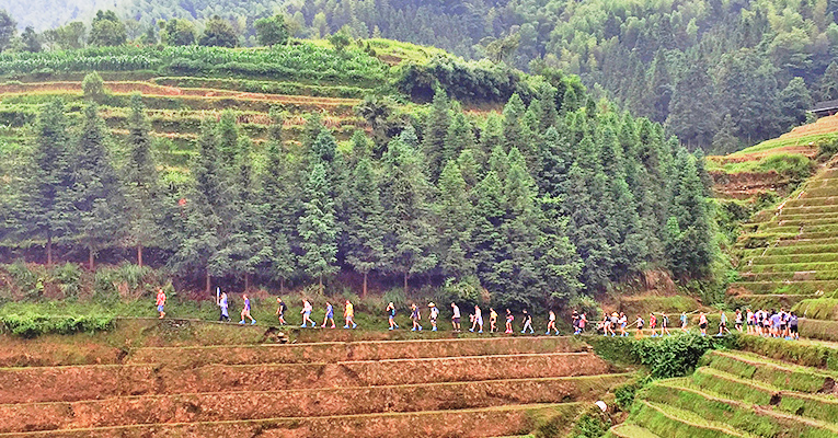 students hiking at ping'an village terraced fields