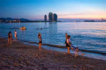 people on the beach in the evening