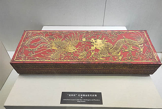 Gilded Red Lacquer Leather Box with Dragons and Phoenixes