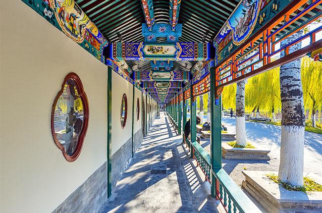a long corridor in the royal garden